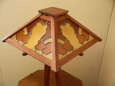 arts and crafts greene and greene style table lamp of african mahogany with hand crafted art glass and hammered copper details
