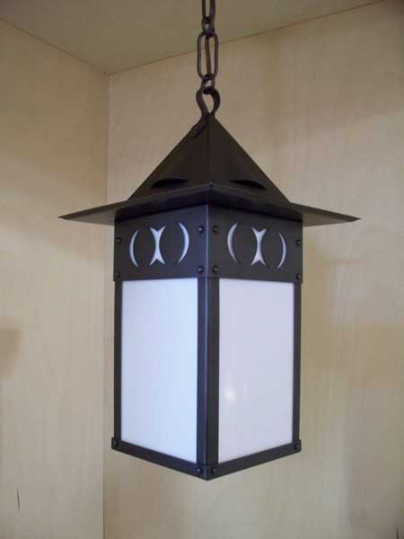 Stickley style lantern with hammered copper and art glass